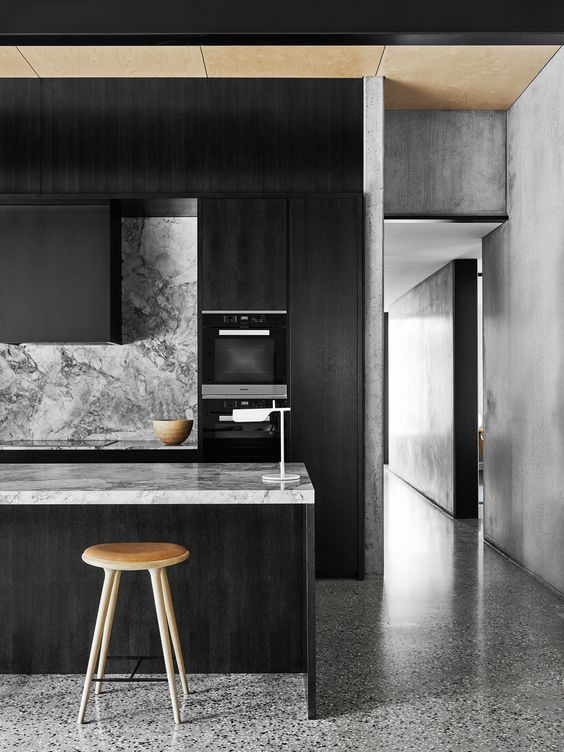 Best Moody Monochrome Kitchen With Veined Marble Surfaces 400 x 300