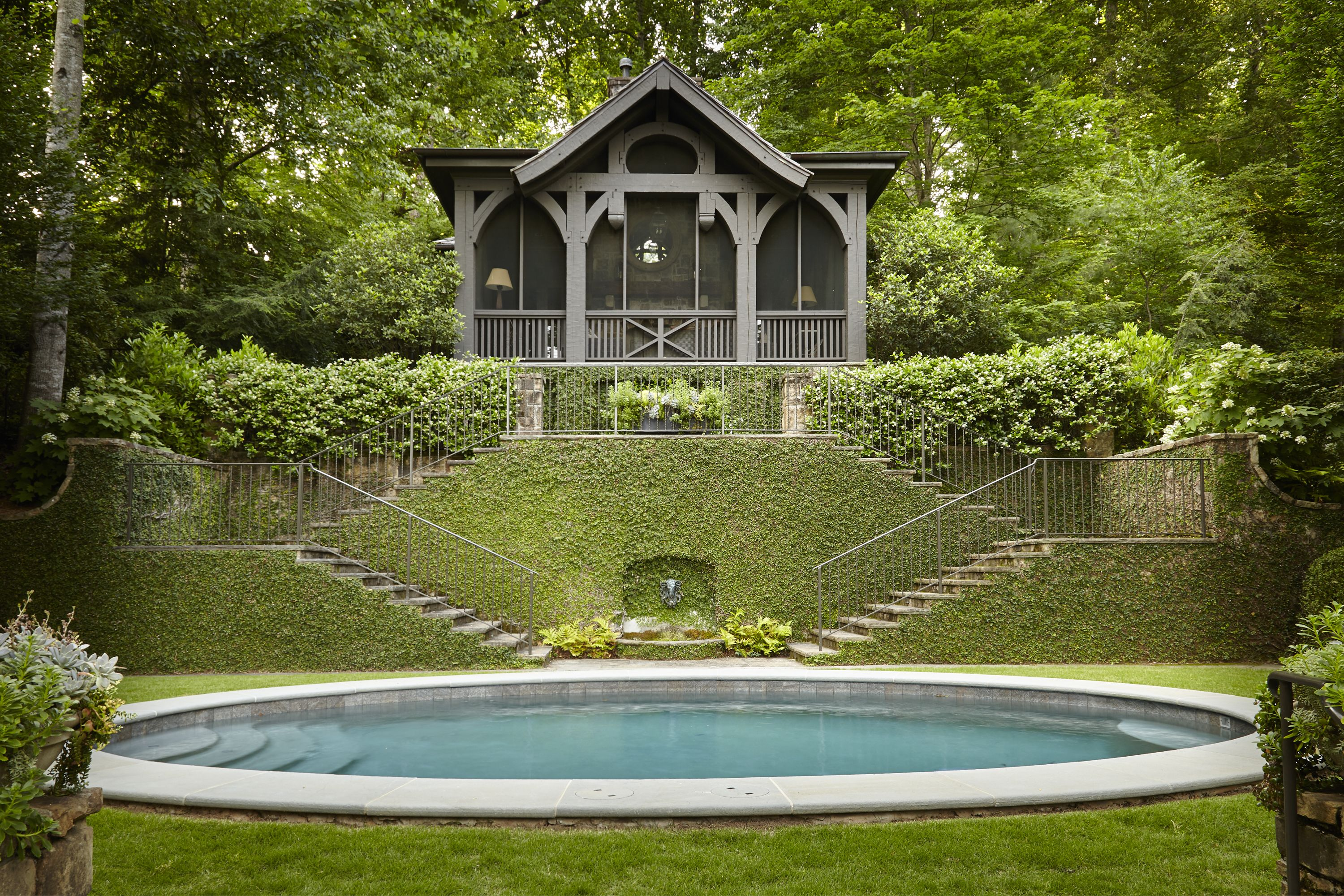 Elliptical Pool And Stone Garden Stairs By Howard Design Studio