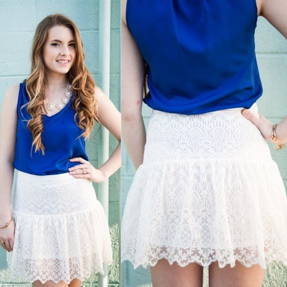White Lace Skirt Whoever says lace is boring or old hasn't laid eyes on this lace skirt! Fun, sophisticated, and just a perfect lace skirt. 80% Cotton/20% Polyamide. Lined. Hidden side zipper. Fitted at hips with flare bottom.   Fits true to size. Model is size 4, wears medium. Skirts