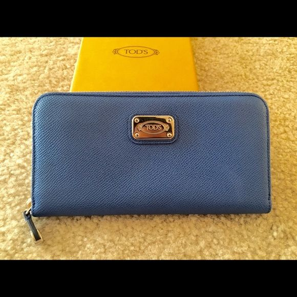 100% authentic tod's d-styling wallet Beautiful blue tod's zip around d-styling wallet! 100% authentic. Comes with original box, authenticity card and protector cloth. Never used and well kept. Offers welcome! No trades Tod's Bags Wallets