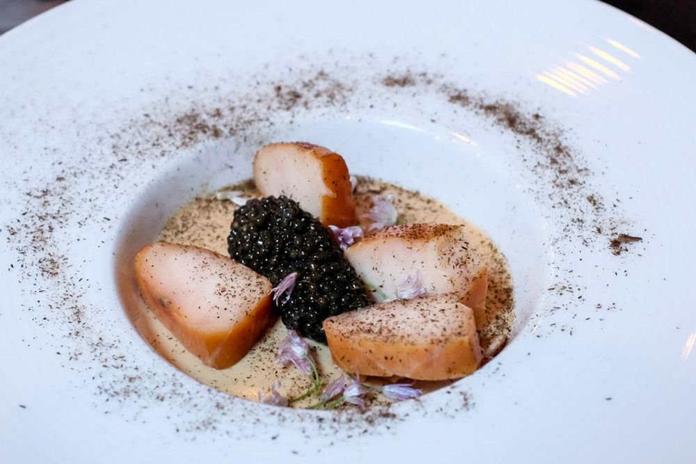 Caramelized onion panna cotta with cured sturgeon and caviar at SPQR in San Francisco.