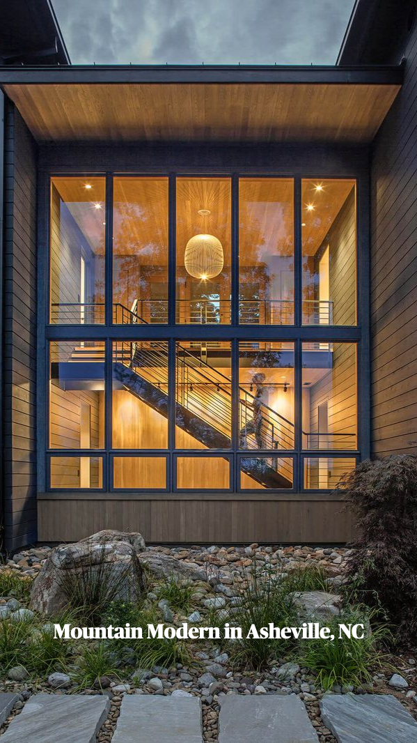 Black wood and glass volumes stagger down woodland in Oregon to form Royal house