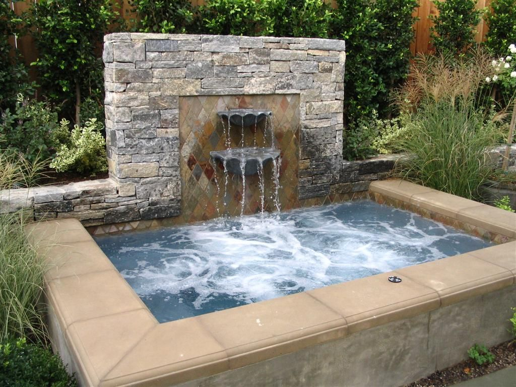 Great hot tub project with water feature would made a for Garden pond tub