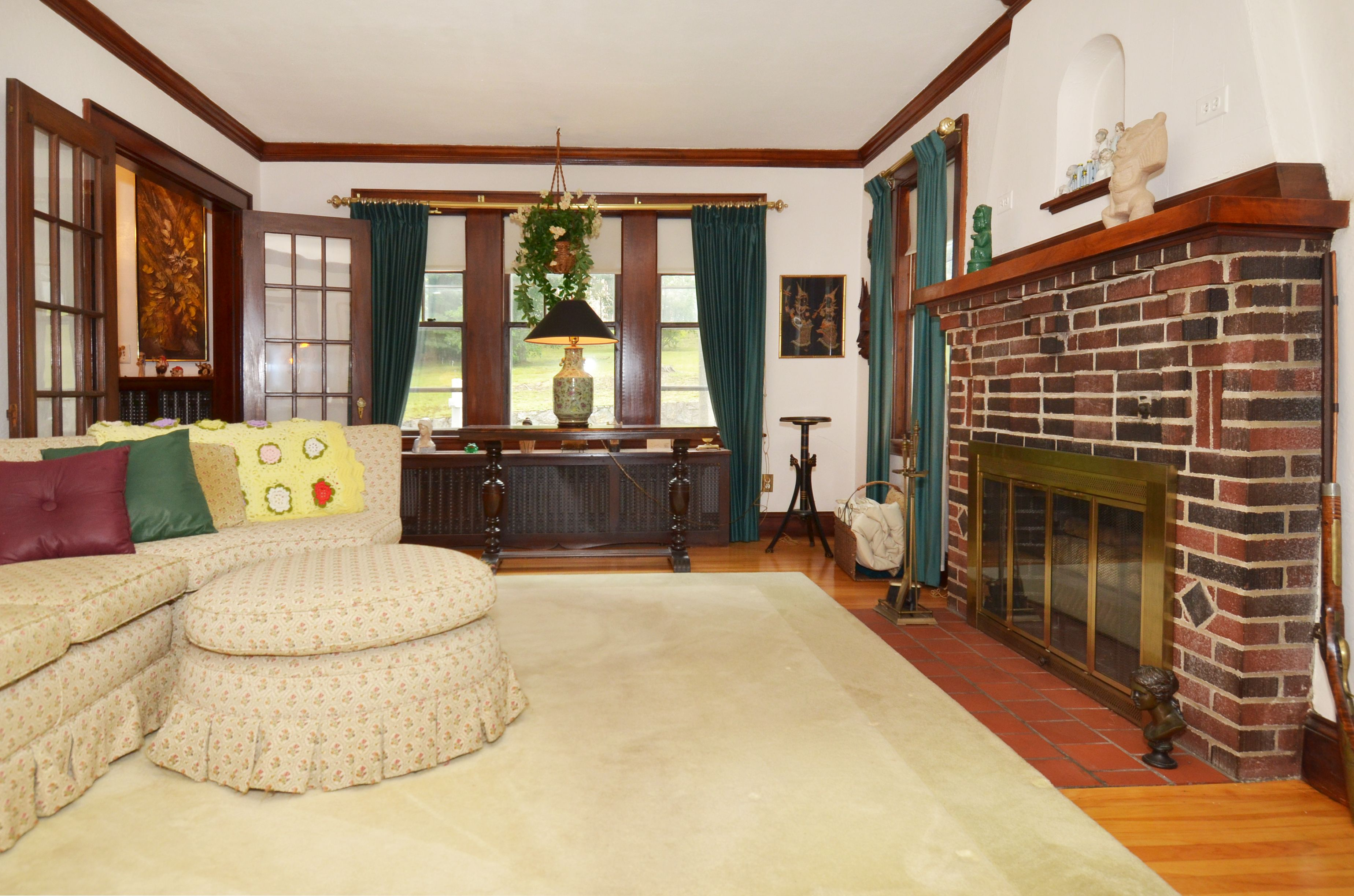 formal living room with fireplace French doors hardwood