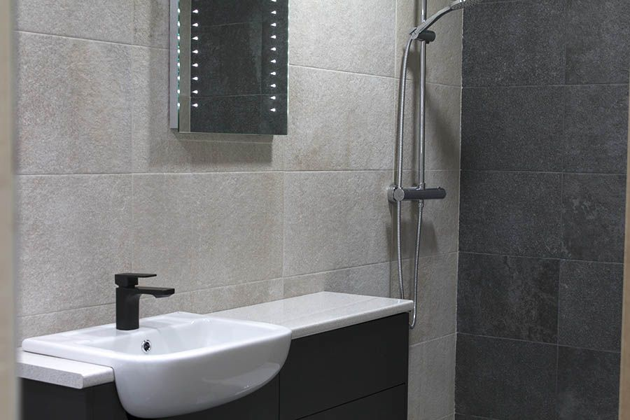 White and black contrasting Marazzi stone effect wall tiles on