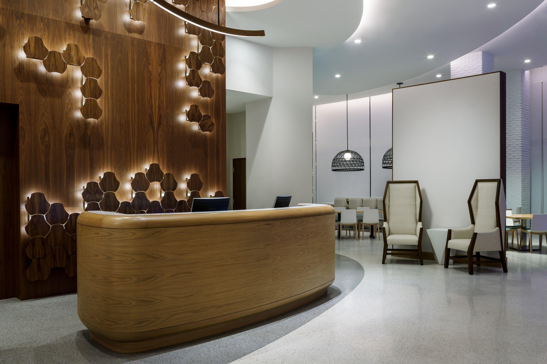 The Front Desk At The Hampton Inn Santa Monica Designed By Hba