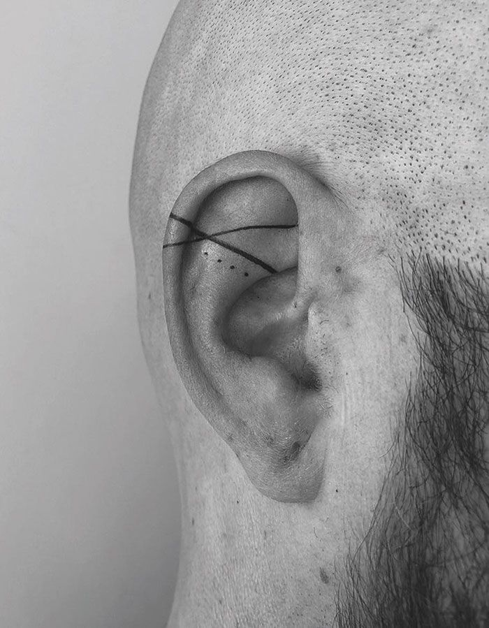 An Ear Tattoo - How Cool Is That. The Abstract Design And Neat Line Work