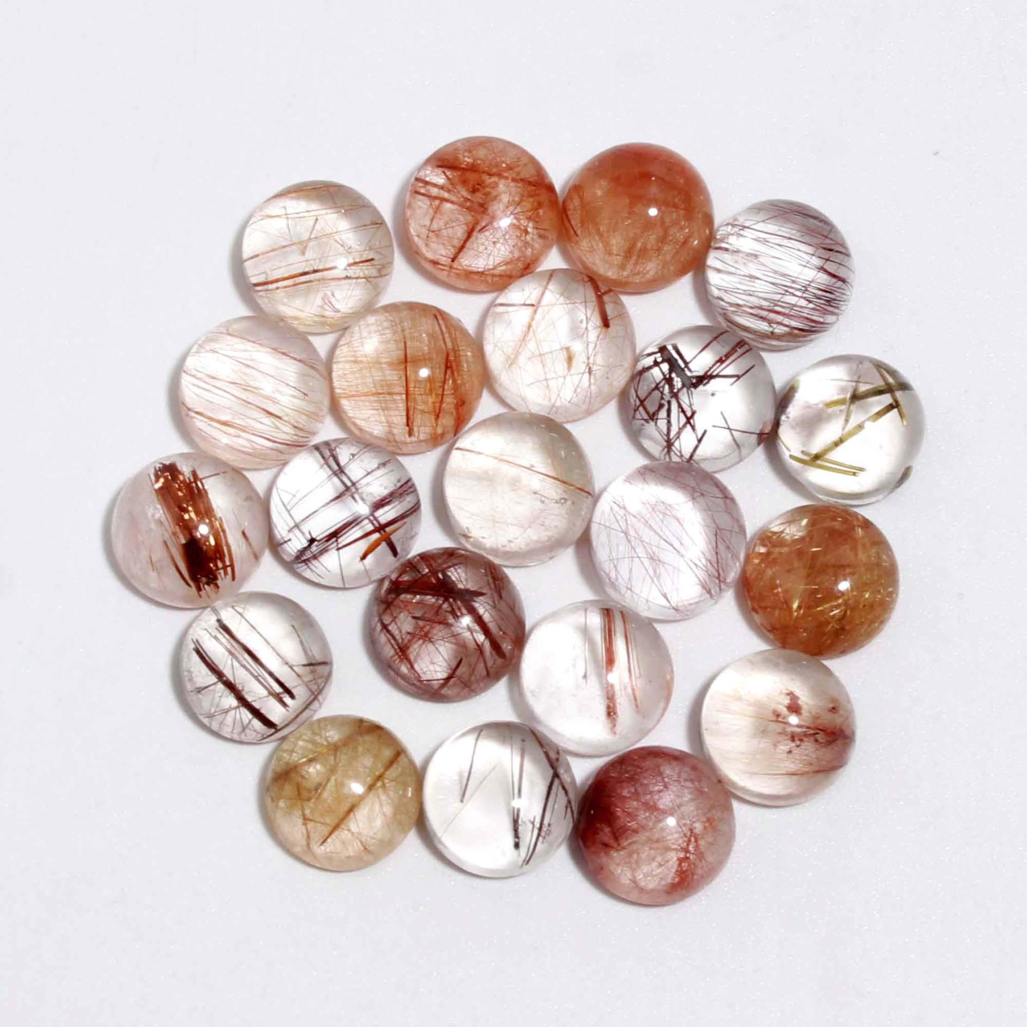 Oval and round sunstone cabochons wrapped with copper wire