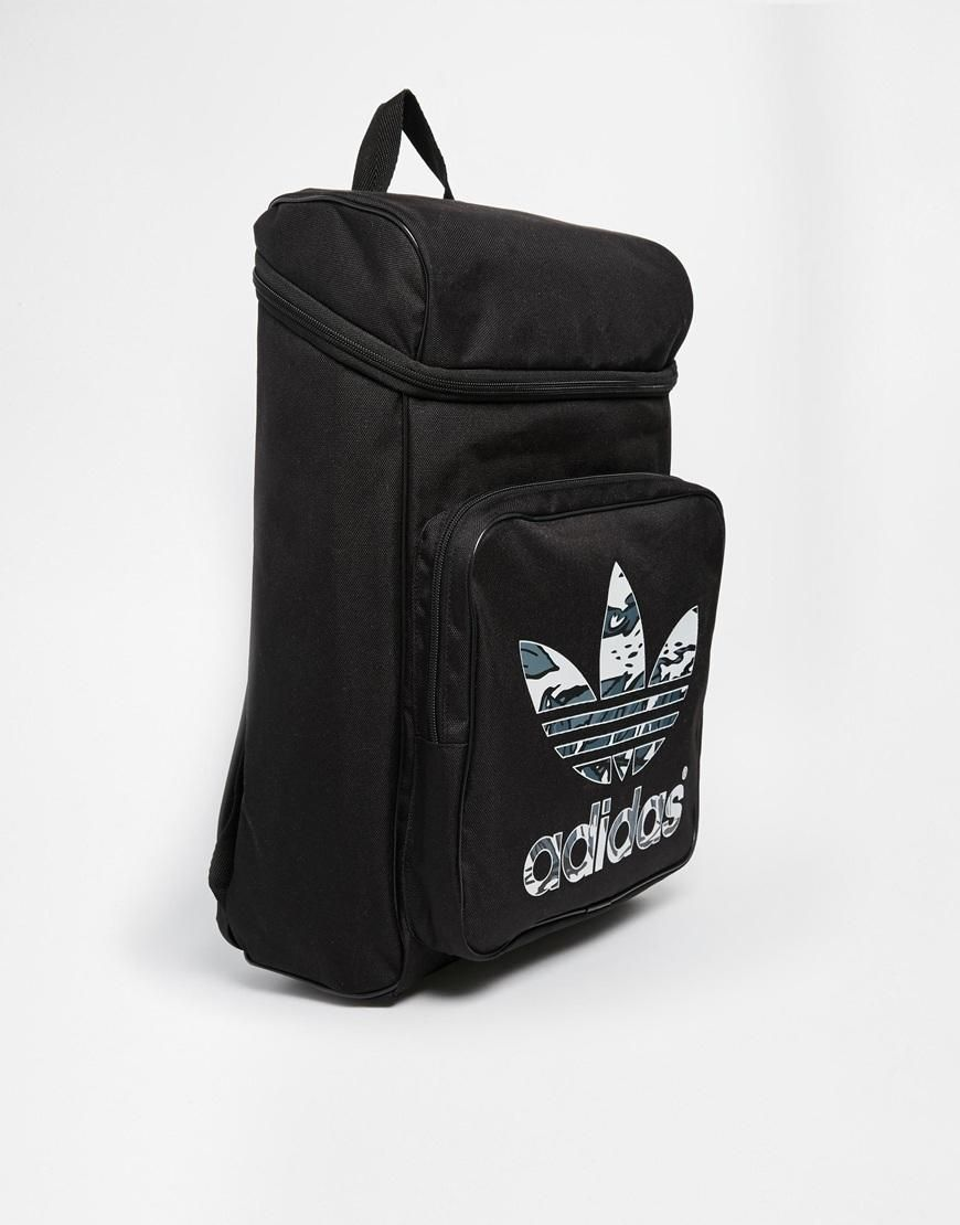 Adidas   Adidas originals Classic Backpack with Printed Logo at ASOS ... 33ab54fc5a