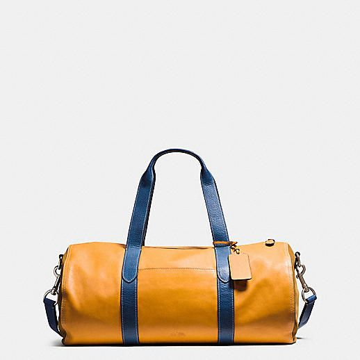 0c97be22cd Lightweight Sport Calf leather and punchy color take the familiar gym bag  silhouette to a bold