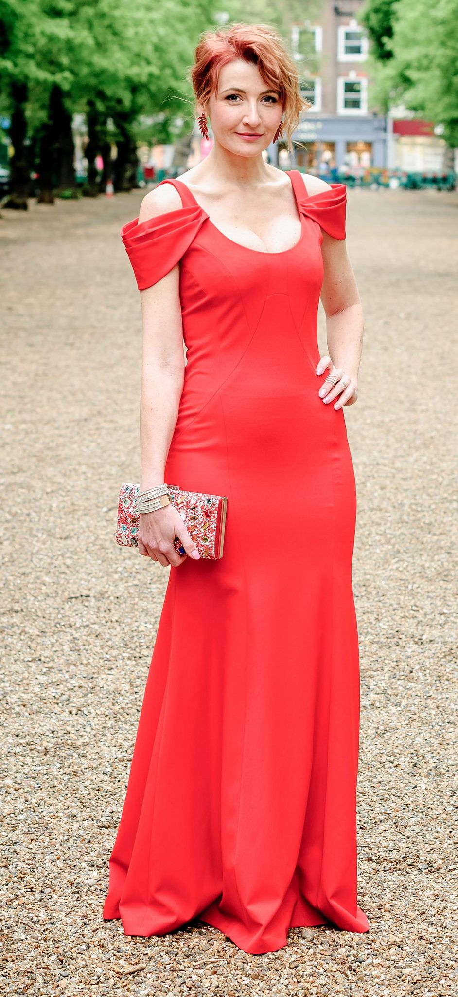 Awards ceremony outfit long red fitted gown with shoulder detail