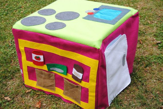 """Felt play kitchen - slides over small end table, folds when the kiddo is done playing! Fridge and oven opens, """"shelves"""" for storing food, cookie jar, etc."""