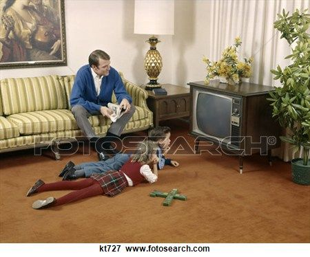 1960 S Father Sitting On Living Room Couch Brother And Sister On Floor Watch Television Family Man Boy Girl Indoor Stock Photo Kt727 Couches Living Room Watch Television Watching Television