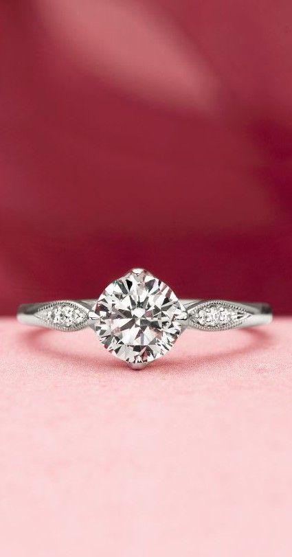 This gorgeous rose gold ring features sparkling pavé set diamonds.