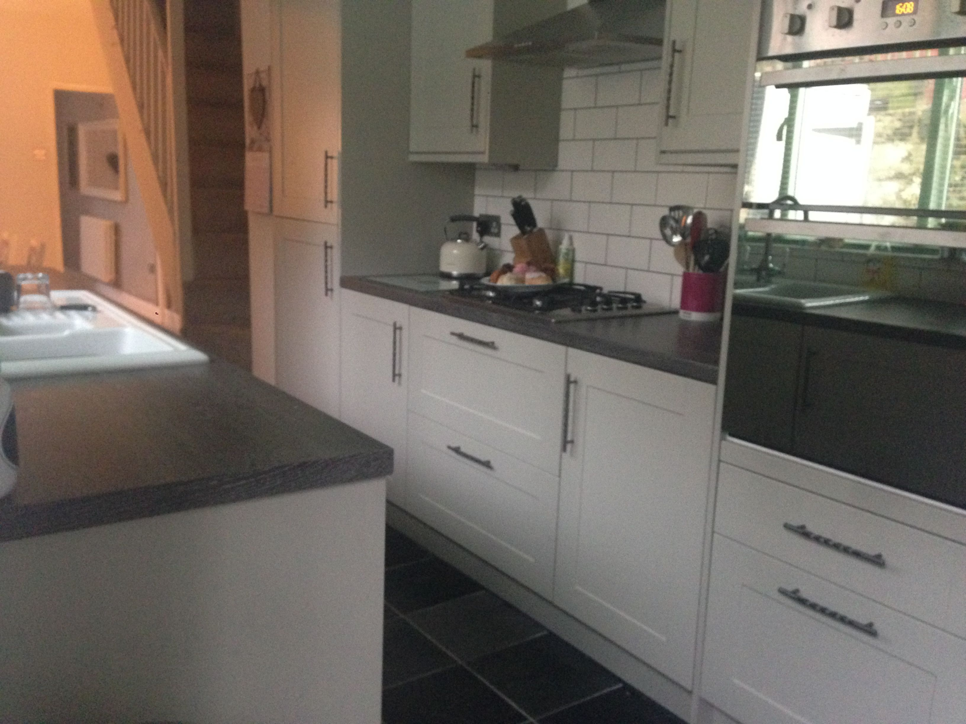 Burford Grey Howdens Kitchen With Cream Metro Tiles Grey