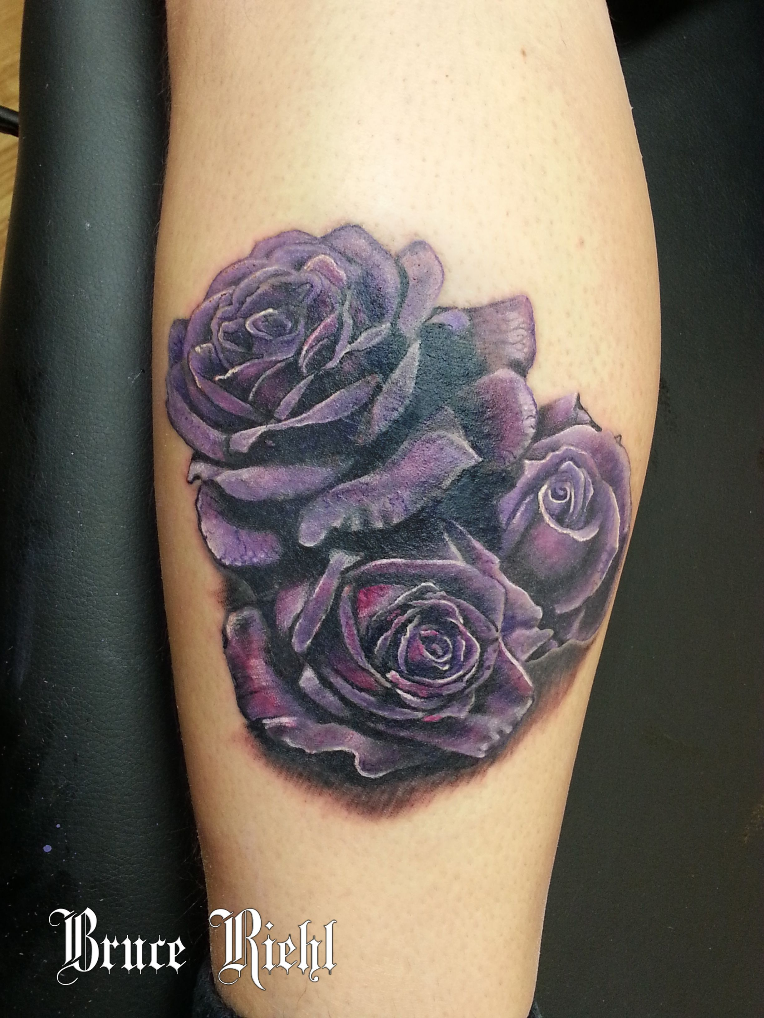 A Purple Realistic Rose Tattoo Cover Up On The Side Of A Leg By