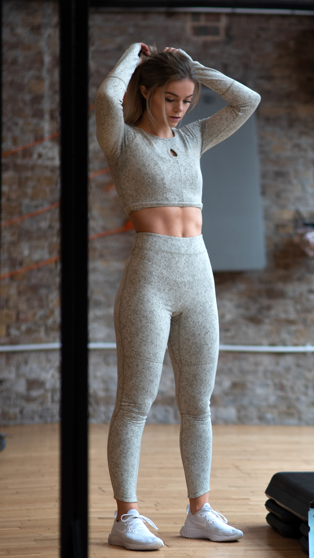 79cbe5ed19a617 Get tough with training in the Fleur Texture collection. Stefanie Moir,  Gymshark Athlete, wears the Washed Khaki Marl Fleur Long Sleeve Crop Top  and ...