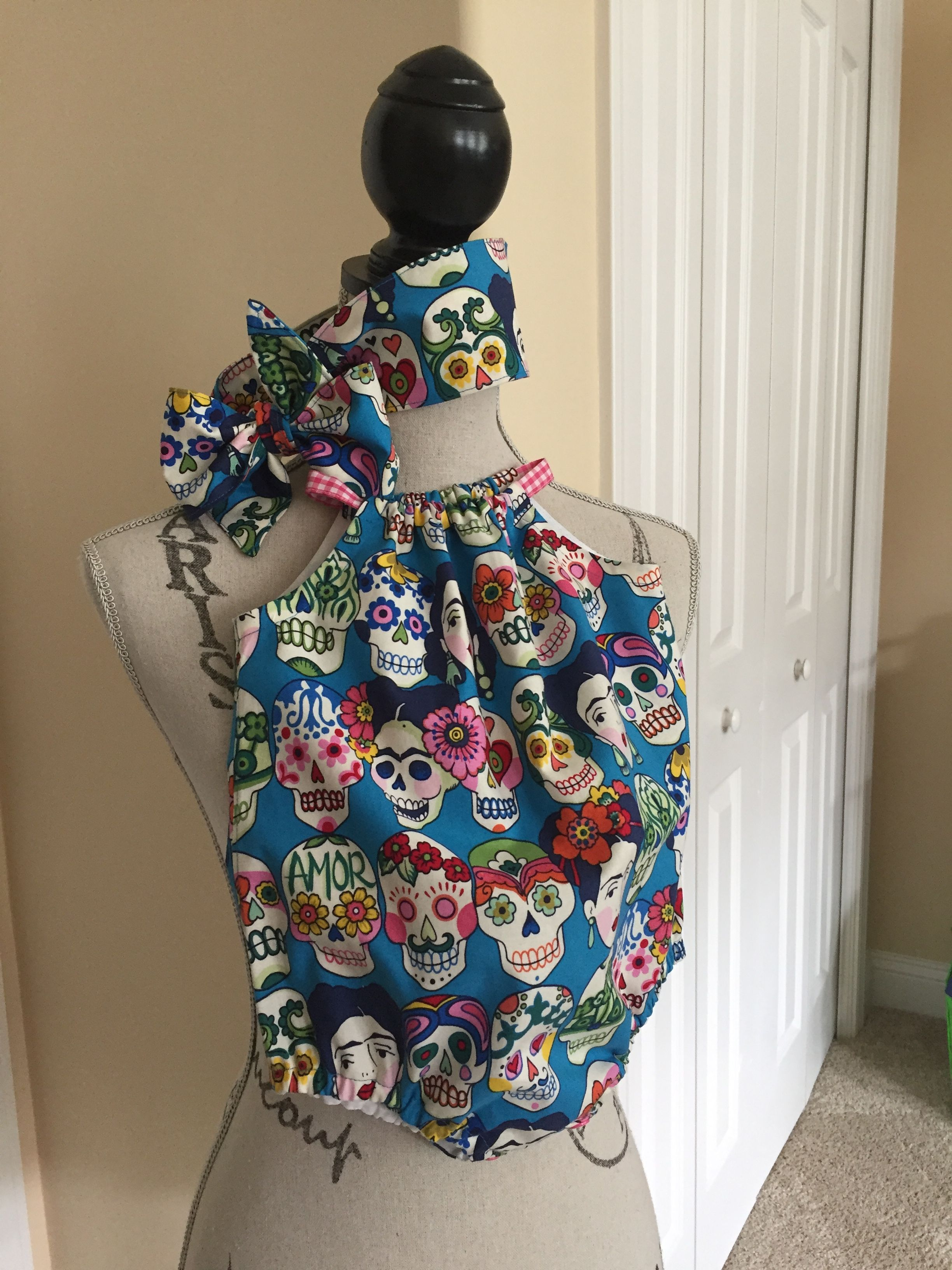 1c151126564 Frida Kahlo sugar skulls romper with matching head wrap. Exclusively at   www.etsy.com shop onceuponawiggle