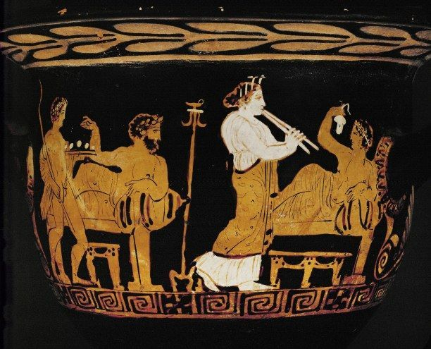 A Scene From A Drinking Party On A Greek Vase Of The