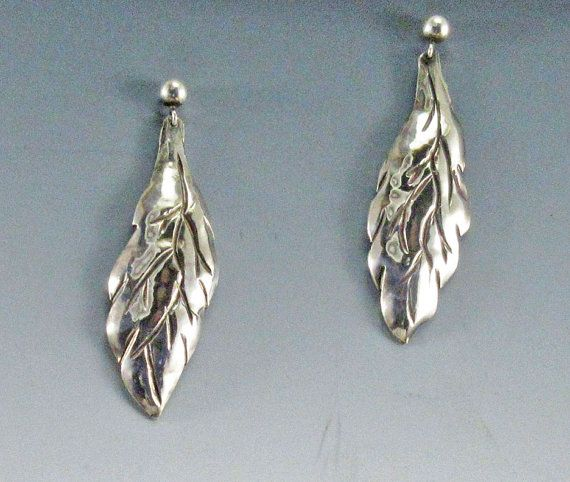These Silver Leaf Earrings a one-of-a-kind sterling silver earrings are suspended from a silver ball and post. They match the Silver Leaf