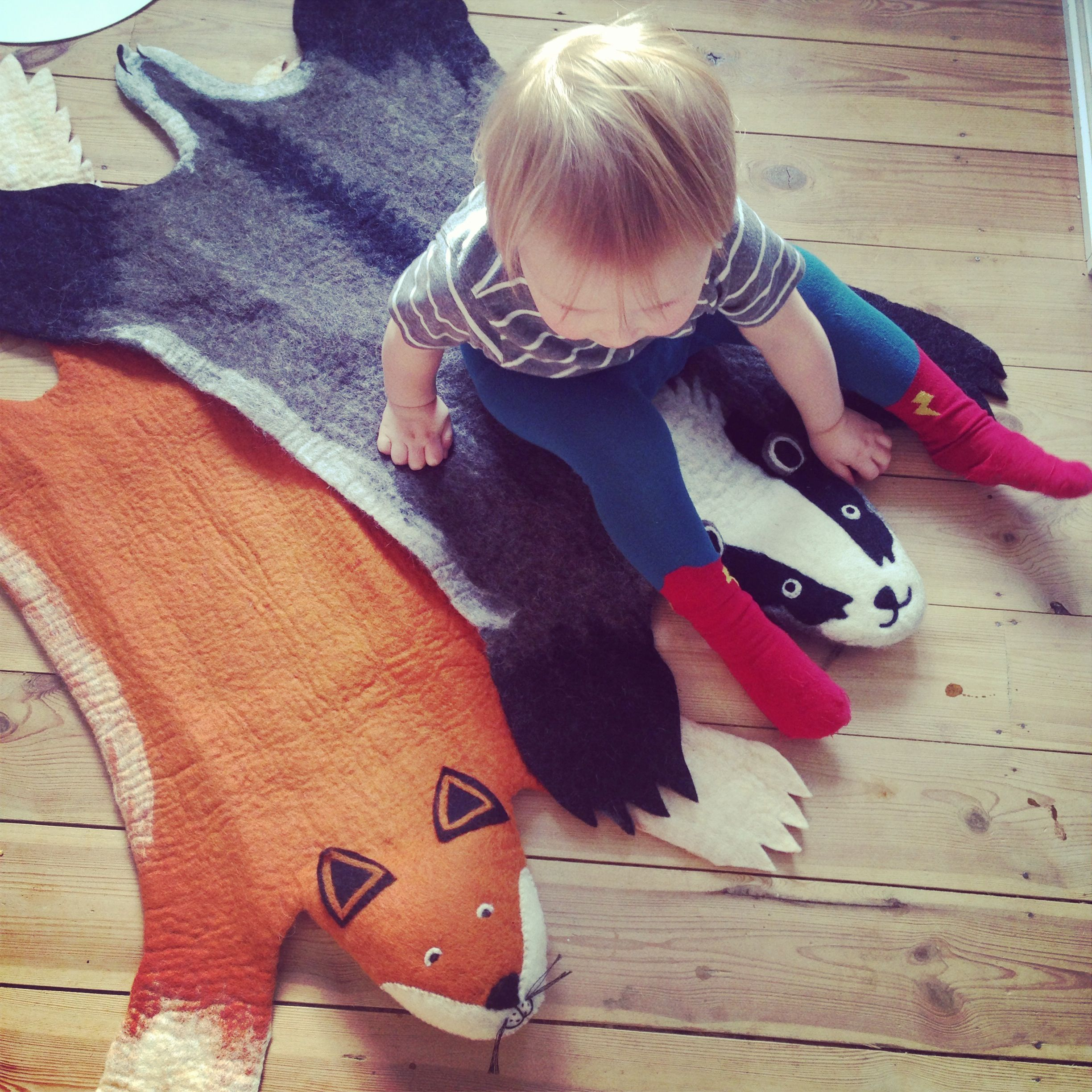 Amazing felted organic wool fox and badger rugs!