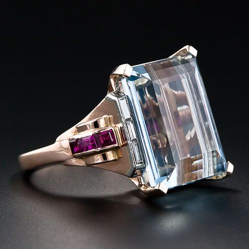 Van Cleef & Arpels Retro Aquamarine Ring A stunning Cocktail Ring by the eminent French and American Jewelry firm Van Cleef & Arpels, circa 1935-1940's. A serene pastel Blue, Emerald cut Aqua, weight approx. 17.00cts. is presented with taste and sophistication in Rose Gold and Baguette Rubies and Diamonds in Chic Retro style. Stamped V.C.A., Reference #23374.