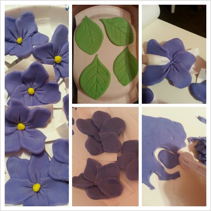 How I made the violets!  Used: Wilton rolled fondant Wilton icing colors Modeling stick(wilton kit) Serrated edge stick (wilton kit) Wilton rolling cutter  1. Knead dye in fondant and roll to desired thickness. 2. I freehanded cutting both leaves and petals, but you can make a stencik and trace. 3. Made veins in leaves with modeling stick. 4. Arranged petals and pinched together in center. 5. Used serrated tool to create petal creases and for extra bonding of petals.  6. Set bonded flowers…