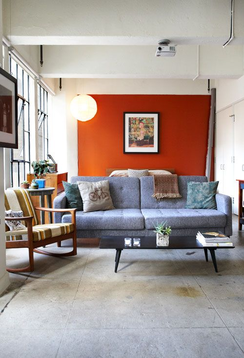 Sneak peek andrea bricco in 2019 home orange accent - Burnt orange feature wall living room ...