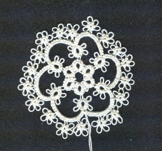 reduced in price shuttle tatted snowflake number 2 by donatajones on Etsy, $4.00