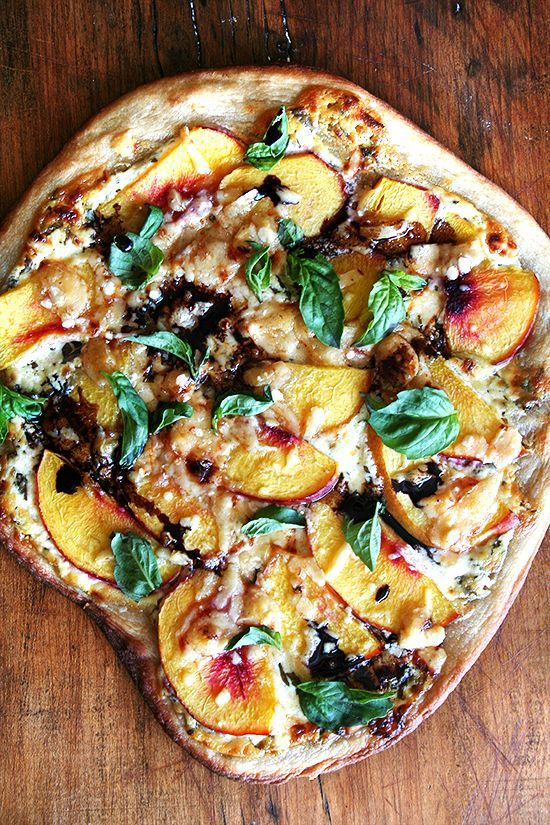 Pizza, with peaches (or nectarines) out of the oven sprinkled with basil and drizzled with balsamic vinegar.