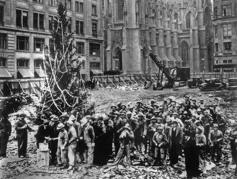 Construction workers line up for pay beside the first Rockefeller ...