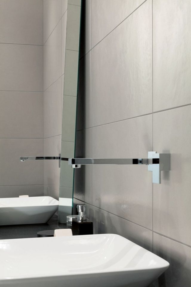 Dual wash basins with wall mounted chrome fixtures.