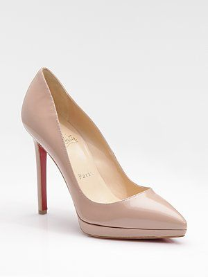 This is a shoe I need to own (albeit, in a less expensive version; I saw basically this same shoe at JC Penney for $50).  Nude patent pumps will go with everything and can be worn with everything from suits, to evening gowns, to skinny jeans. - Christian Louboutin Pigalle Plato Patent Leather Platform Pumps, $775 at Saks Fifth Avenue.