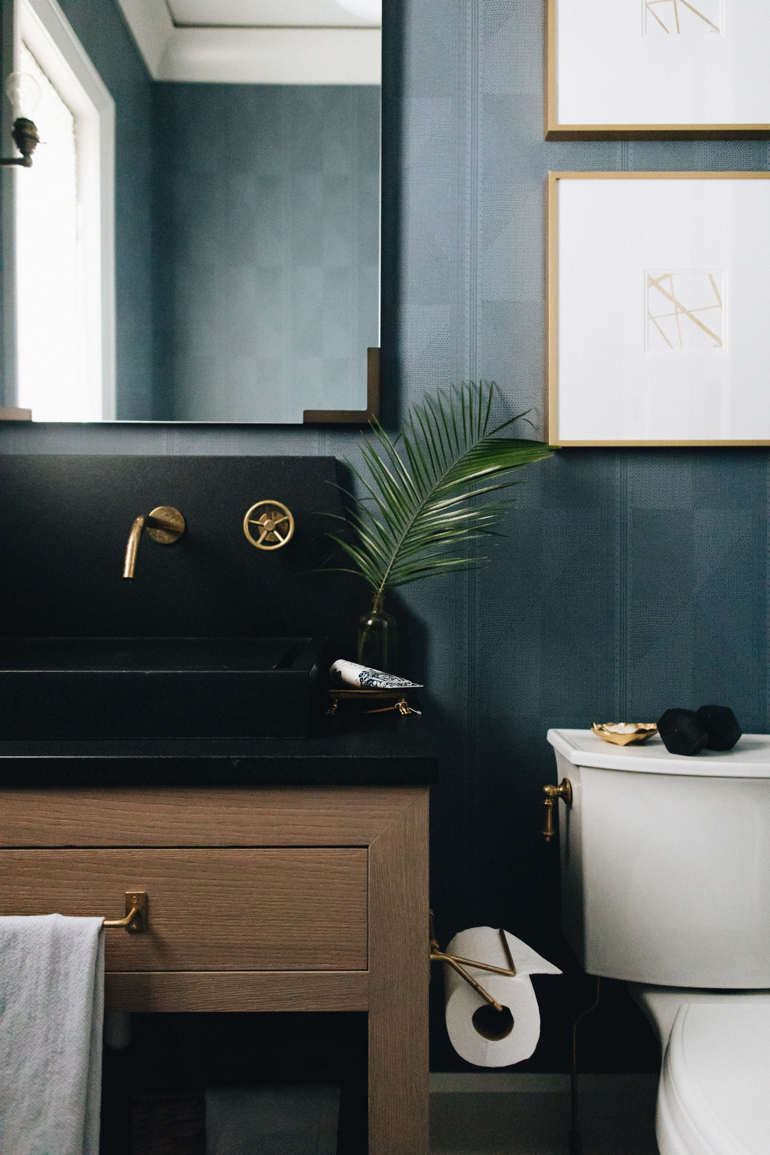Bright but moody bathroom. Love that wall mount faucet! Design via ...