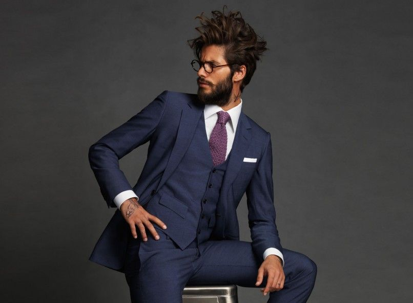 The must have blue suit and on a big quiff babe