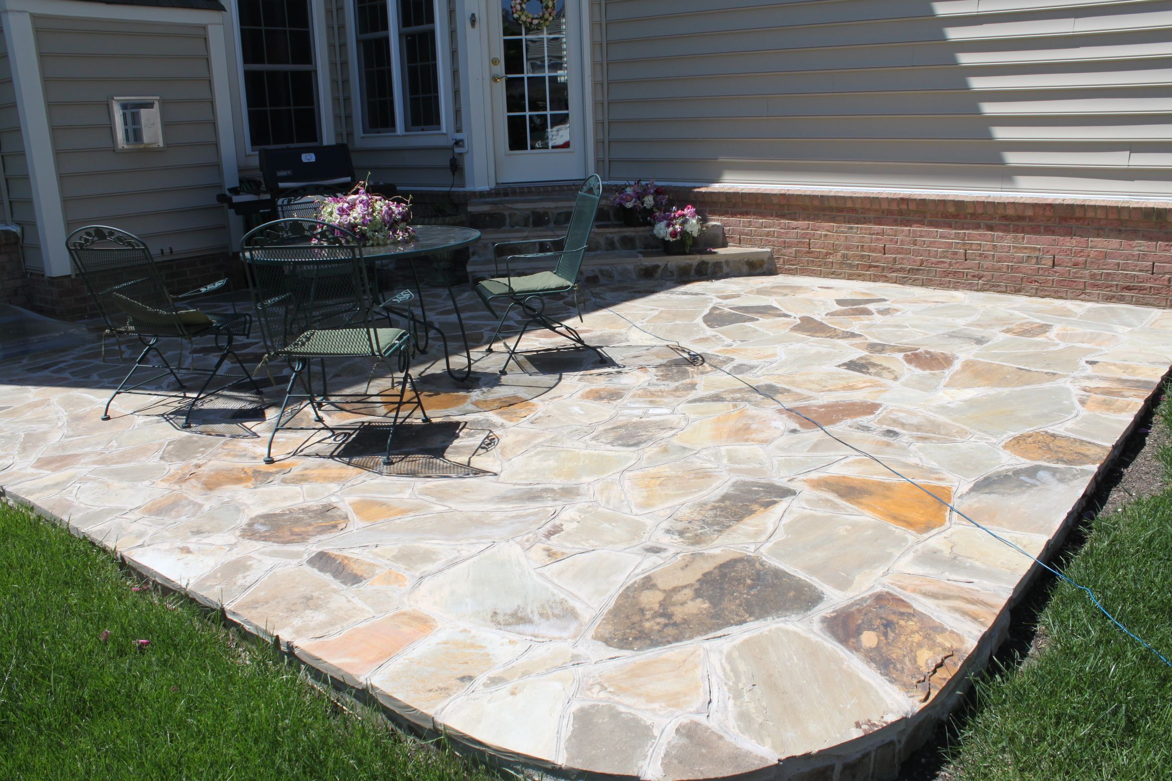 a beautiful irregular flagstone patio in brambleton by blue moon