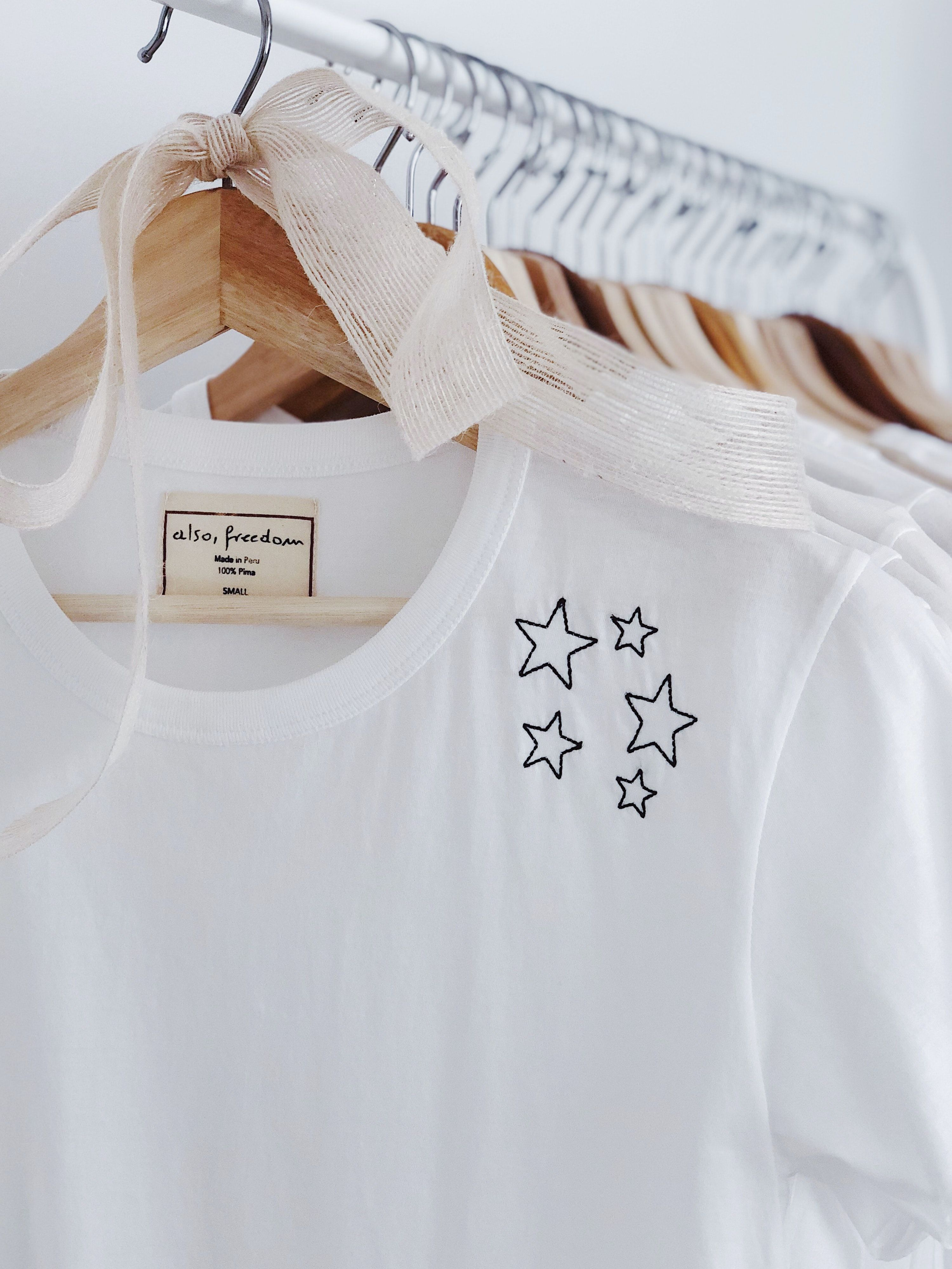 """The """"Sprinkle of Courage Tee"""" imposes on you a secretempowerment throughout the day while knowing that the starsrepresent that sprinkle of courage you need to accomplish anythingyou want."""