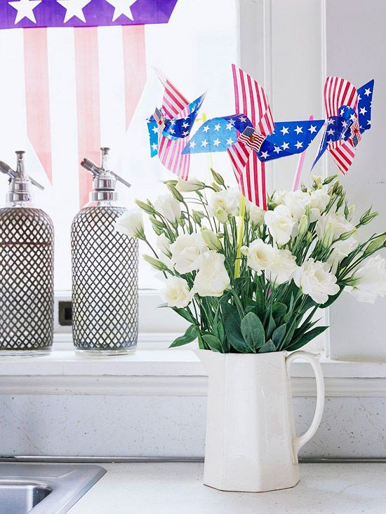 Add patriotic pinwheels to fresh-cut flowers for a simple 4th of July bouquet. More easy #Independence #Day decorations: http://www.bhg.com/holidays/july-4th/decorating/easy-diy-decorations-for-the-4th-of-july/?socsrc=bhgpin062612#page=23