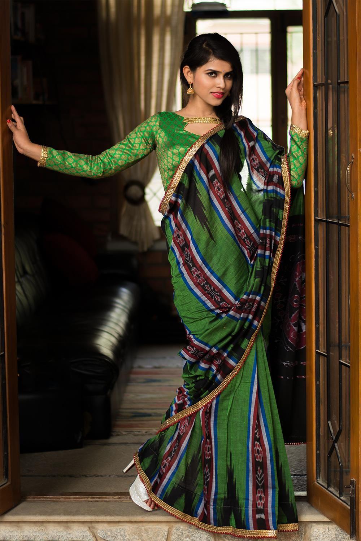 f4701721718 Dark green Sambalpuri Ikat pure cotton saree with gold sequin and red pom  pom border  saree  sambalpuri  houseofblouse