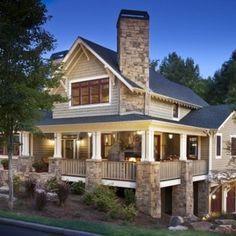 wrap around porch and stone work. gorgeous.