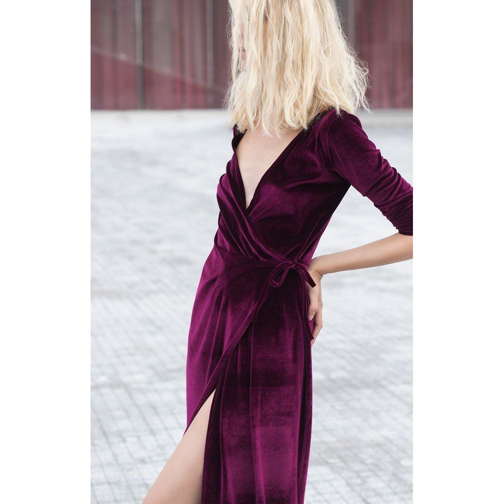 Season's hottest new trend is the luxurious velvet. The hot dark pink velvet dress has wrap up fit with side lace closure and a front slit. The dress has long sleeves and a dramatic plunging neckline.