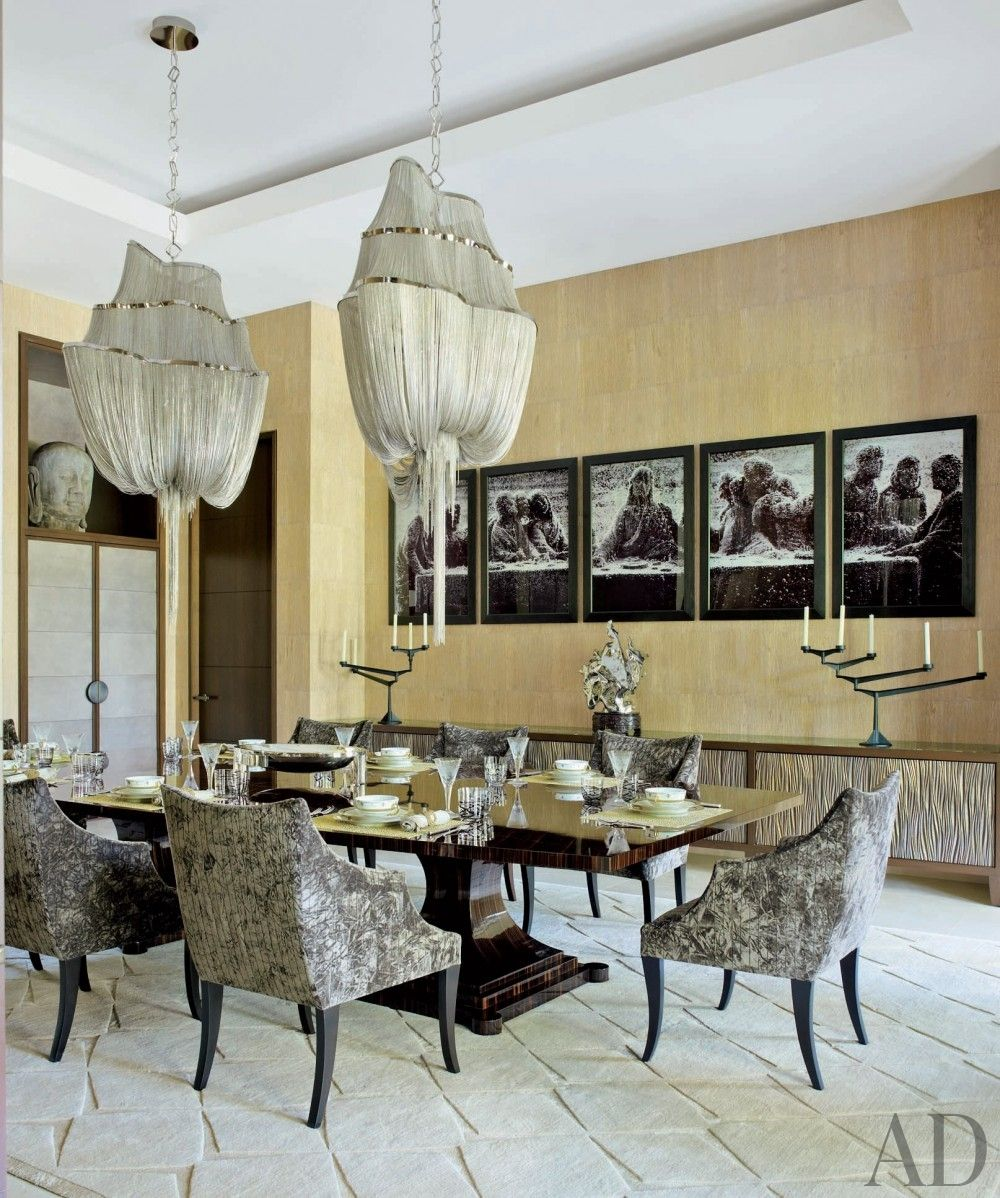 Eye-catching ceiling fixtures hang above the table in the dining room of a Palladian-style Florida residence