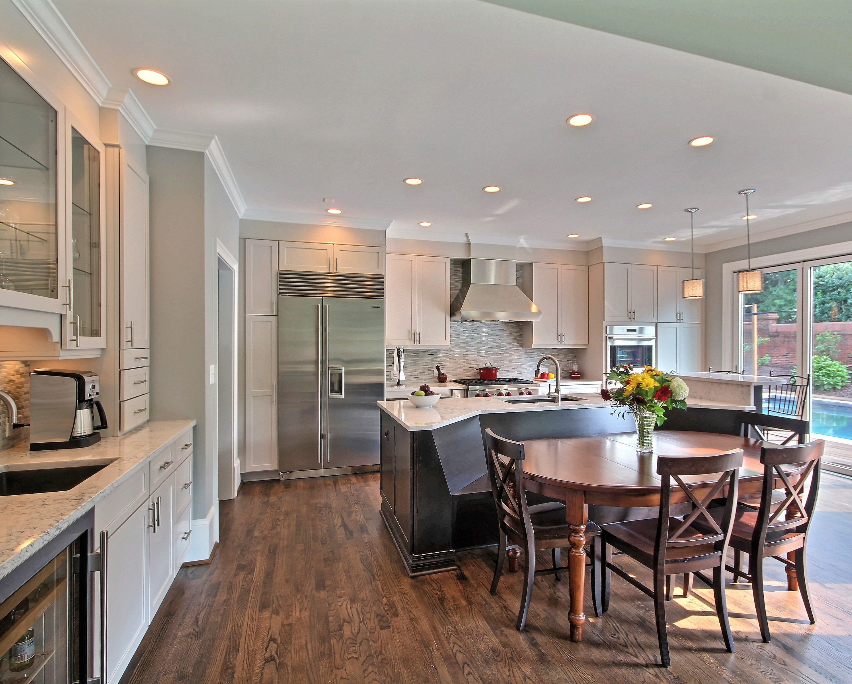 Open Kitchen With Bench Seating Area White Cabinets