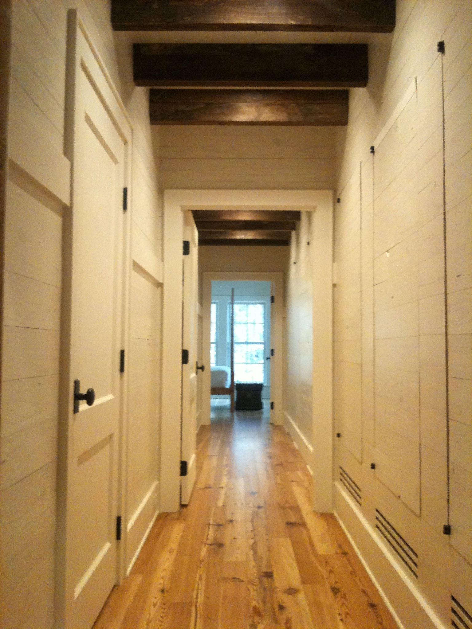 Closets and HVAC registers integrated into planked walls | Hidden ...