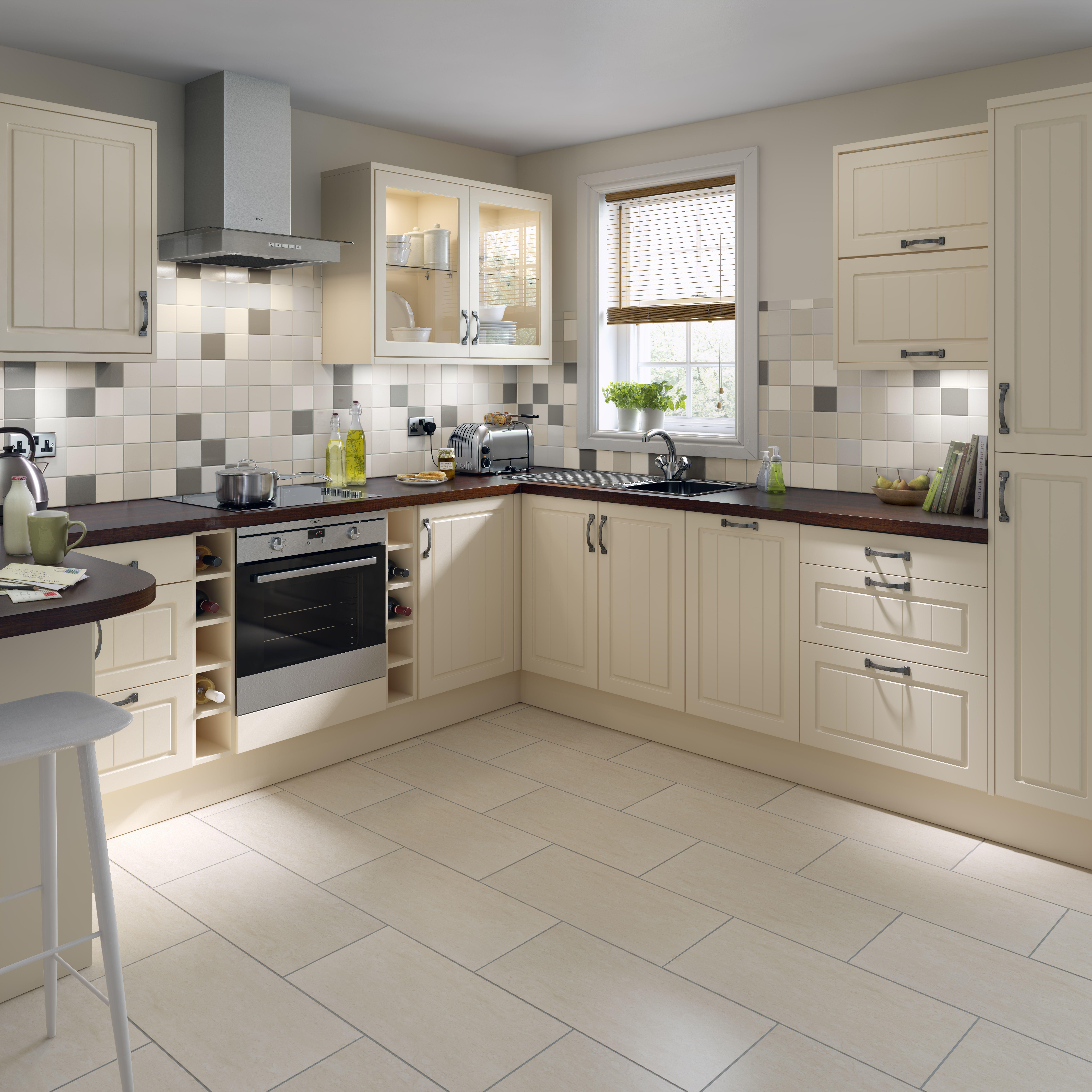 Classic farm house kitchen with matt cream doors and floor tiles ...
