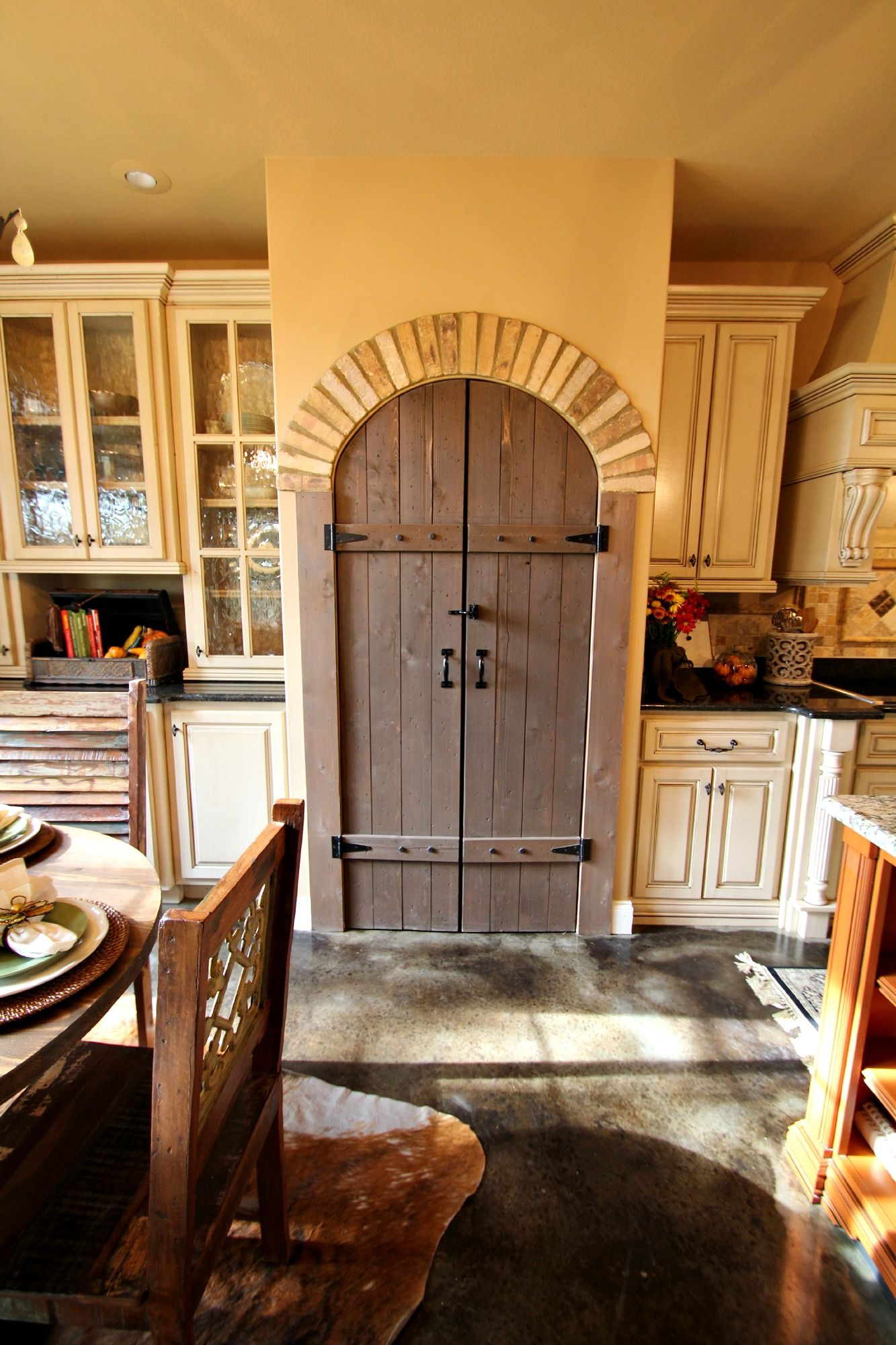 Arched Pantry Door With Brick Accents Distressed Cabinets