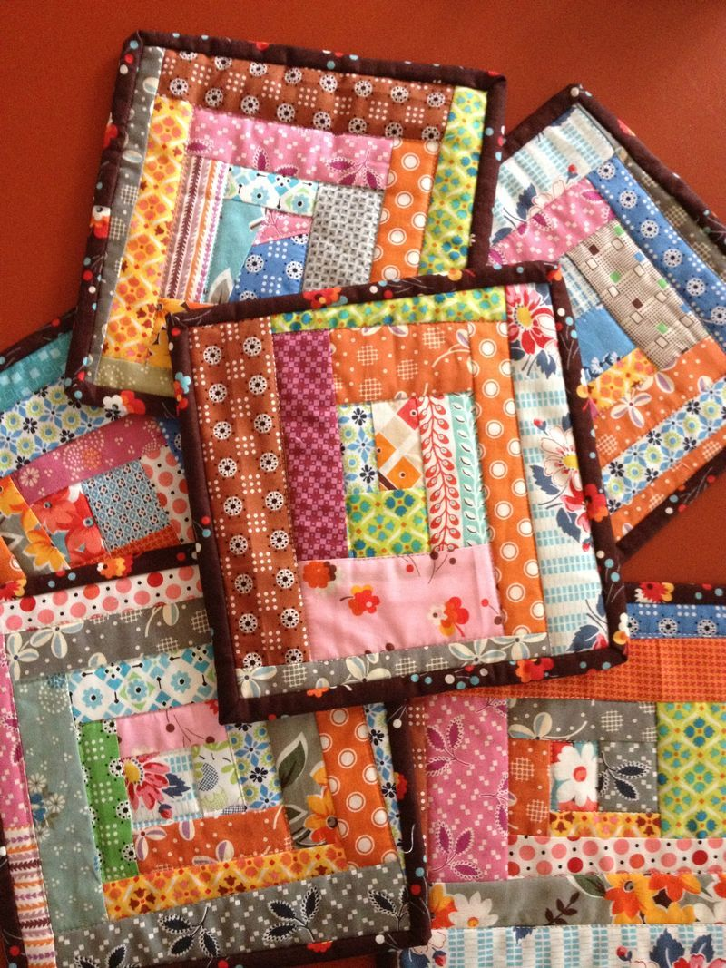 Pile of fun quilted pot holders or mug rugs