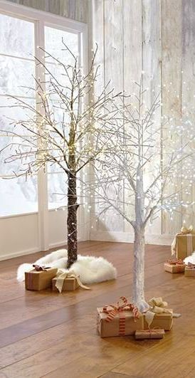 Lighted Stick Trees Are An Unconventional Stylish Option For The Holidays Forgo The Tradi Twig Christmas Tree Christmas Tree Branches Winter Tree Decorations
