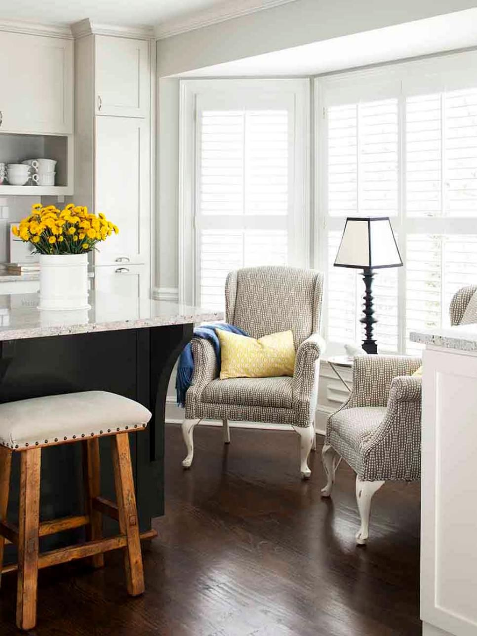 A pair of neutral wingback chairs create a small sitting - Small bedroom sitting area ...