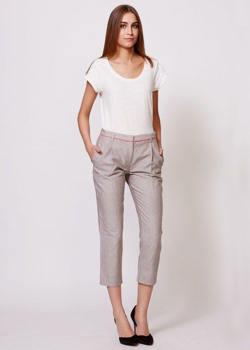 People Tree | Sherry Cropped Trousers in Beige. Handwoven cotton trousers in beige, with contrast piping. Front and back pockets, zip and button fastening, ankle button detail. Pairs well with a Melanie Tabard jumper or an organic cotton top.